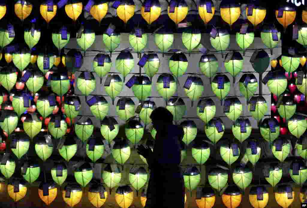 A woman prays in front of lanterns to celebrate the New Year at Jogyesa Buddhist temple in Seoul, South Korea.