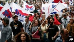 Supporters of the communist-affiliated union PAME chant slogans during an anti-austerity rally in Athens, Greece, May 22, 2016.