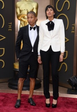 Pharrell Williams, left, and Helen Lasichanh arrive at the Oscars on March 2, 2014, at the Dolby Theatre in Los Angeles.