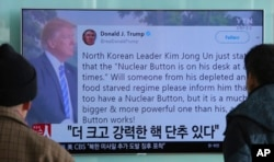 People watch a TV news program showing U.S. President Donald Trump's tweet while reporting on North Korea's nuclear threat, at Seoul Railway Station in Seoul, South Korea, Jan. 3, 2018.
