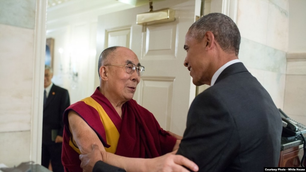 Obama embraces dalai lama at personal meeting at white house president barack obama greets his holiness the dalai lama at the entrance of the map room m4hsunfo Image collections