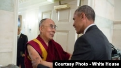 President Barack Obama greets His Holiness the Dalai Lama at the entrance of the Map Room of the White House, June 15, 2016.