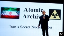 Israeli Prime Minister Benjamin Netanyahu presents material on Iranian nuclear weapons development during a press conference in Tel Aviv April 30 2018.