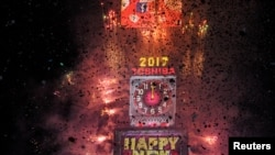 Fireworks and confetti mark the new year in Times Square in New York, U.S. Jan. 1, 2017.