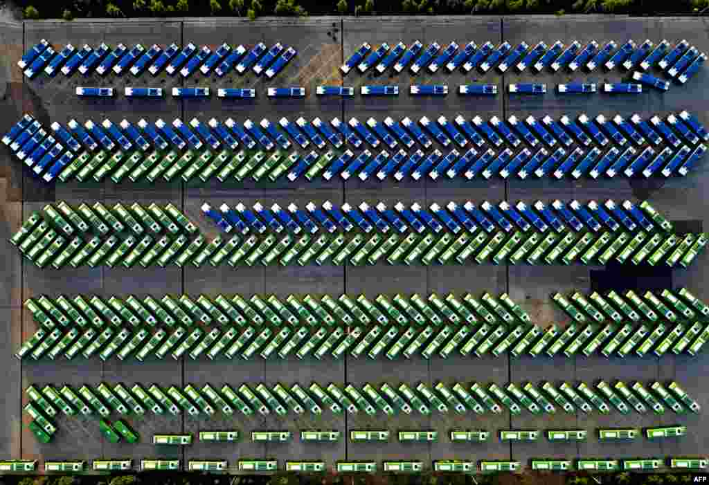 An aerial view shows city buses parked in the bus depot following the suspension of public transport services amid concerns over the spread of the Covid-19 pandemic in Tbilisi, Georgia.