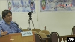 FILE - An image grab from footage obtained from Iranian State TV IRIB shows Ruhollah Zam, a former opposition figure who had lived in exile in France and was implicated in anti-government protests, speaking in a courtroom during a trial.