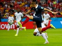 France's Karim Benzema shoots to score during the 2014 World Cup Group E soccer match between France and Honduras at the Beira Rio stadium in Porto Alegre, June 15, 2014.