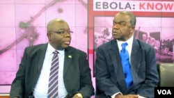 H.E. Bockari Stevens, Sierra Leone's ambassador to the United States, chats with Malonga Miatudila, a physician and Ebola expert, at VOA in Washington, Nov. 19, 2014.