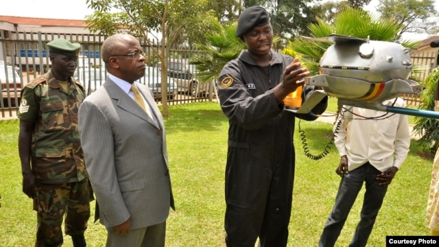 Ugandan Prime Minister Amama Mbabazi inspects Chris Nsamba's space probe in March, 2013. (Photo: African Space Research Program)