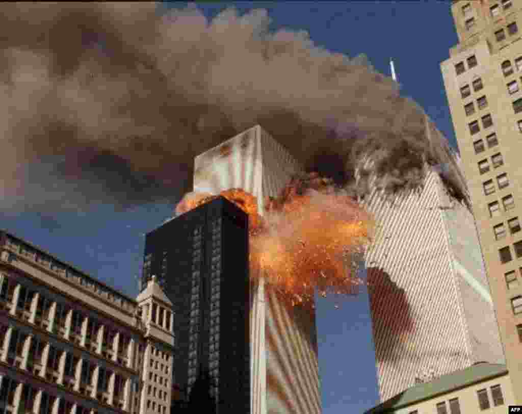THIRD OF A SERIES OF FOUR PHOTOS--Smoke billows from one of the towers of the World Trade Center and flames and debris explode from the second tower, Tuesday, Sept. 11, 2001. In one of the most horrifying attacks ever against the United States, terrorists