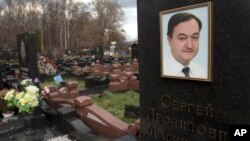 A tombstone on the grave of lawyer Sergei Magnitsky who died in jail, at a cemetery in Moscow, November 16, 2012.