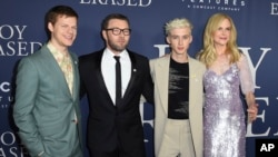 """FILE - From left, Lucas Hedges, Joel Edgerton, Troye Sivan and Nicole Kidman arrive at the Los Angeles premiere of """"Boy Erased,"""" Oct. 29, 2018, at the Directors Guild of America. The movie has given momentum to the drive to ban gay conversion therapy for minors."""