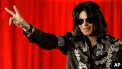 FILE - Michael Jackson at a press conference at London's O2 Arena, March 5, 2009.
