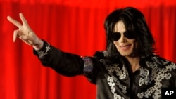 In this March 5, 2009 file photo Michael Jackson announces that he is set to play ten live concerts at the London O2 Arena in July, which he announced at a press conference at the London O2 Arena.