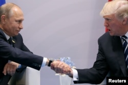 U.S. President Donald Trump shakes hands with Russian President Vladimir Putin during the their bilateral meeting at the G-20 summit in Hamburg, Germany, July 7, 2017.