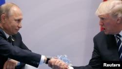 نخستین دیدار مستقیم دونالد ترامپ رئیس جمهوری آمریکا و ولادیمیر پوتین رئیس جمهوری روسیه در حاشیه نشست گروه ۲۰ در آلمان - ۱۶ تیر ۱۳۹۶