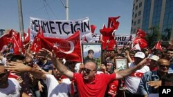 Protesters shout slogans against the outlawed Kurdistan Workers Party (PKK) during a demonstration in Istanbul, July 17, 2011