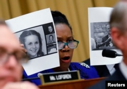 Rep. Sheila Jackson Lee (D-TX) holds up pictures of women who've accused U.S. Senate candidate Roy Moore of sexual misconduct, while questioning U.S. Attorney General Jeff Sessions (Not Pictured) during the House Judiciary Committee oversight hearing on