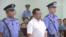 被控涉嫌煽动颠覆国家政权罪的维权律师江天勇在长沙中级人民法院出庭受审。(长沙中院微博图片 2017年8月22日)
