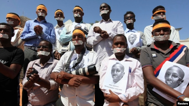 Somali journalists, in Mogadishu on Jan. 27, 2013, demand the release of Abdiaziz Abdinur Ibrahim, who was arrested after reporting on an alleged rape case involving government soldiers.