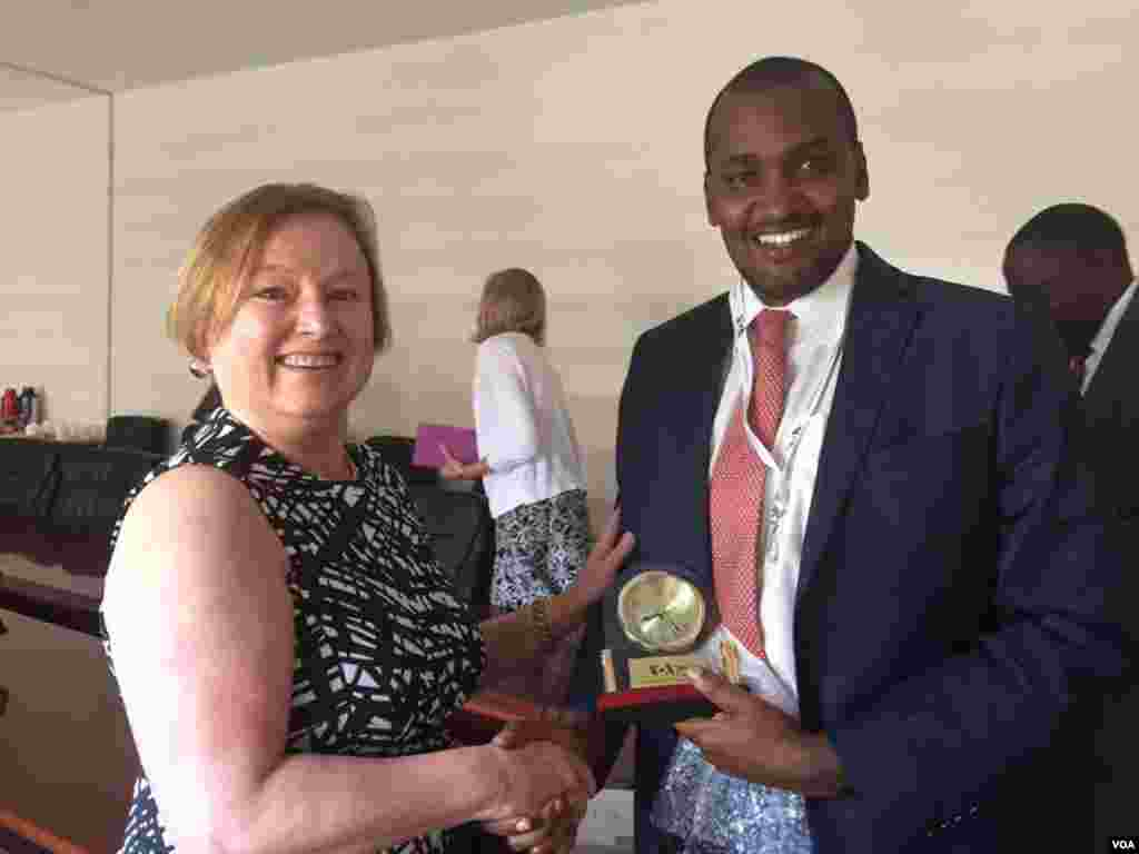 VOA Director Amanda Bennett with Uganda's Minister for ICT & National Guidance, Frank K Tumwebaze, in Kampala, Uganda