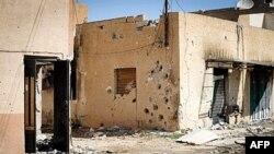 Kuća u četvrti Bira u libijskom gradu Mistrati, izrešetana mecima i artiljerijom