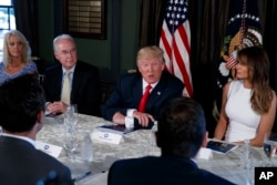 President Donald Trump speaks during a briefing on the opioid crisis, Aug. 8, 2017, at Trump National Golf Club in Bedminster, N.J. From left are, White House senior adviser Kellyanne Conway, Health and Human Services Secretary Tom Price, Trump, and first