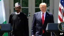 President Donald Trump and Nigerian President Muhammadu Buhari arrive for a news conference in the White House Rose Garden in Washington, April 30, 2018.