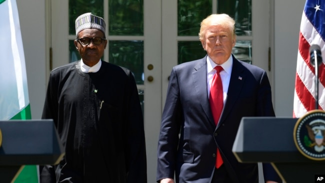 President Donald Trump and Nigerian President Muhammadu Buhari arrive for a news conference in the Rose Garden of the White House in Washington, April 30, 2018.