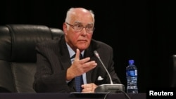 Retired Judge Ian Farlam speaks as the judicial commission of inquiry into the shootings at Lonmin's Marikana mine gets underway in Rustenburg, October 1, 2012.
