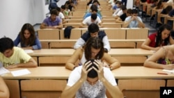 Students take a university entrance examination at a lecture hall in the Andalusian capital of Seville, southern Spain. Researchers created a technique involving having test-takers write down their fears – in turn dramatically improving their test scores