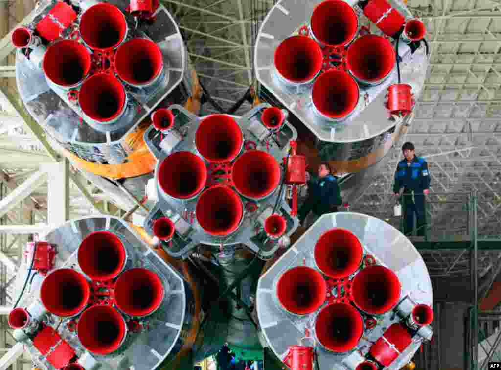 April 1: Preparations for launching Russian Soyuz TMA-21 spaceship that will carry a new crew to the international space station, are under way in an assembly shop at the Baikonur cosmodrome, Kazakhstan. (AP Photo/Dmitry Lovetsky)