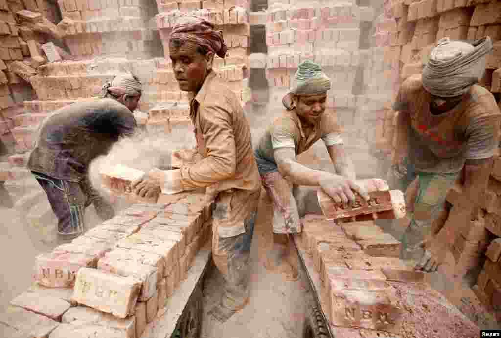 Laborers work at a brick factory in Dhaka, Bangladesh.