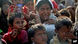 A rescued migrant weeps upon arrival Simpang Tiga, Aceh province, Indonesia, May 20, 2015. Many Rohingya and Bangladeshi migrants are trapped at sea in a growing crisis confronting Southeast Asia. (AP Photo/Binsar Bakkara)