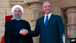 Serê Îranê Hasan Ruhanî (Ç) Serokomarê Îraqê Berham Salih(R)