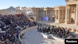 Russia's Mariinsky Theatre performs at the amphitheatre of the Syrian city of Palmyra, Syria in this handout picture provided by SANA, May 5, 2016.