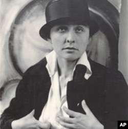 American artist Georgia O'Keeffe, seen here in a portrait from 1918, is best known for her paintings of flowers and landscapes, but she was also a gifted abstract artist.