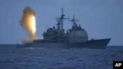 In a photo provided by the U.S. Navy, a Standard Missile-3 (SM-3) is launched from the Aegis cruiser USS Shiloh (CG 67), during a joint Missile Defense Agency, U.S. Navy ballistic missile flight test, off the coast of Kauai, Hawaii.(File Photo)