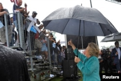 U.S. Democratic presidential nominee Hillary Clinton acknowledges the crowd at a campaign rally in the rain in Pembroke Pines, Fla., Nov. 5, 2016.
