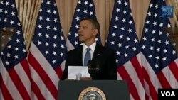 Presiden AS Barack Obama memberikan pidato di kantor Departemen Luar Negeri AS, Kamis (19/5).