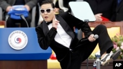 In this Feb. 25, 2013 photo, South Korean rapper PSY performs before President Park Geun-hye's presidential inauguration ceremony in Seoul, South Korea.