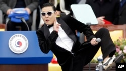 FILE - In this Feb. 25, 2013 file photo, South Korean rapper PSY performs before President Park Geun-hye's presidential inauguration ceremony at the National Assembly in Seoul.