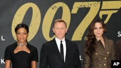 "FILE - Cast members Naomie Harris, left, Daniel Craig, center, and Berenice Marlohe pose together during a photo call for the new James Bond film ""Skyfall"" in New York, October 2012."