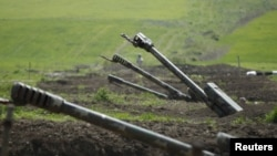 FILE - Armenian artillery is seen near Nagorno-Karabakh's boundary, April 8, 2016.