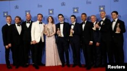 "FILE - The cast and crew of ""La La Land"" pose after winning the award for Best Motion Picture - Musical or Comedy among other awards backstage during the 74th Annual Golden Globe Awards in Beverly Hills, California, Jan. 8, 2017."