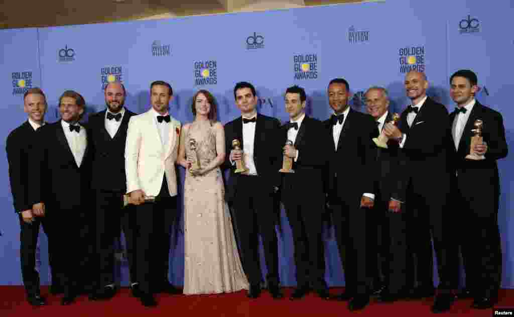 "The cast and crew of ""La La Land"" pose after winning the award for Best Motion Picture - Musical or Comedy among other awards backstage during the 74th Annual Golden Globe Awards in Beverly Hills, CA Jan. 8, 2017."