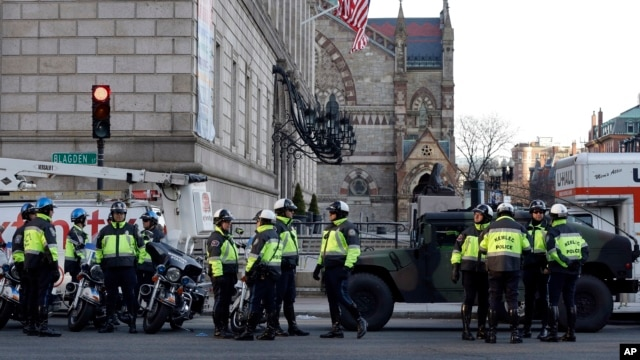 Boston police officers keep a perimeter secure in Boston's Copley Square as an investigation continues into the bomb blasts at the finish area of the Boston Marathon that killed 3 and injured more than 140 people, April 16, 2013.