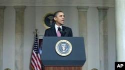President Barack Obama makes a statement on the resignation of Egypt's President Hosni Mubarak in the Grand Foyer at the White House, February 11, 2011
