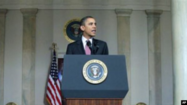 President Barack Obama makes a statement on the resignation of Egypt's President Hosni Mubarak in the Grand Foyer at the White House, February 11, 2011