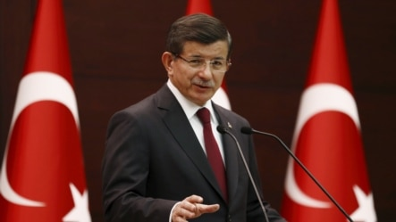 "Turkey's Prime Minister Ahmet Davutoglu speaks during a news conference in Ankara, Turkey, August 25, 2015. Davutoglu urged Turkey's opposition parties to ""assume their responsibilities"" on Tuesday and join an interim power-sharing government, saying he w"